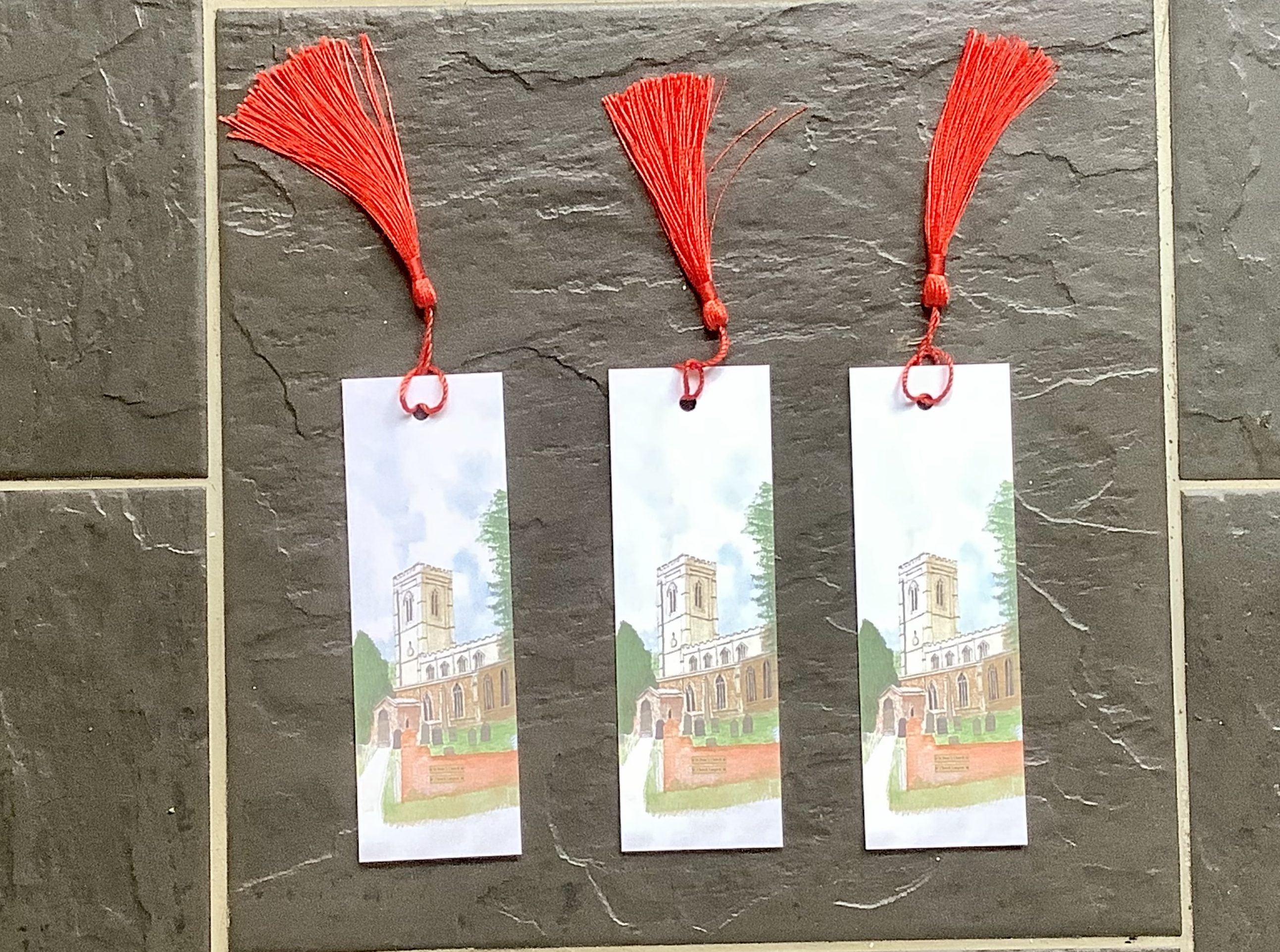 Three bookmarks, with smart red tassel
